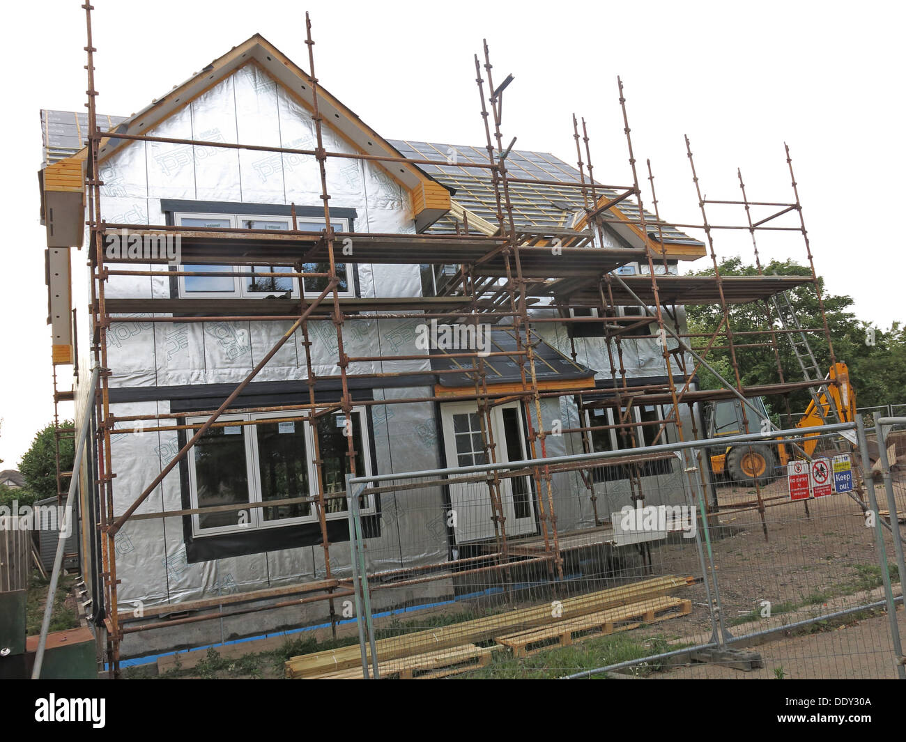 Timber Framed House under construction Eskbank Dalkeith Midlothian Scotland UK showing silver reflective foil - Stock Image