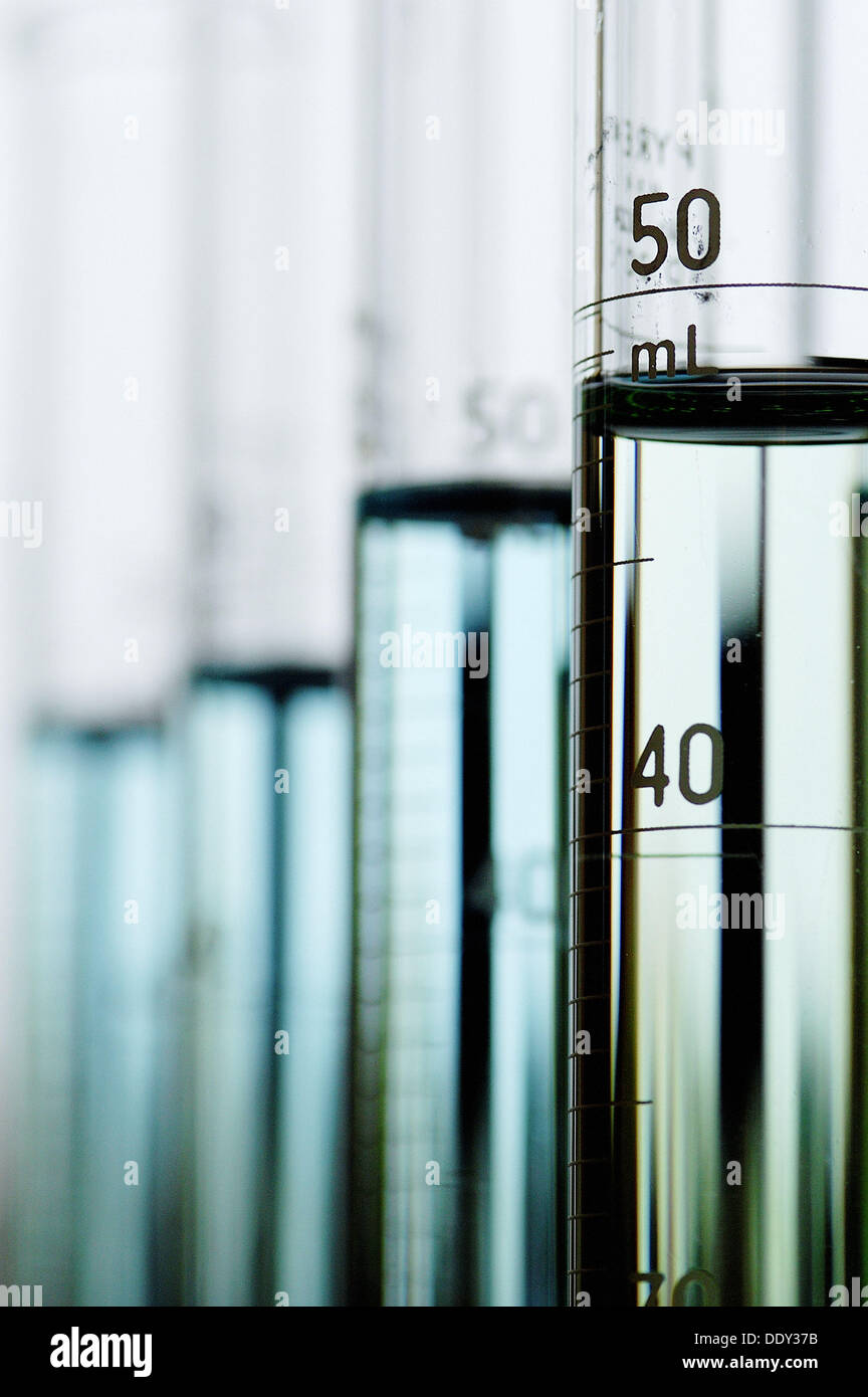 Staggered row graduated cylinders. - Stock Image