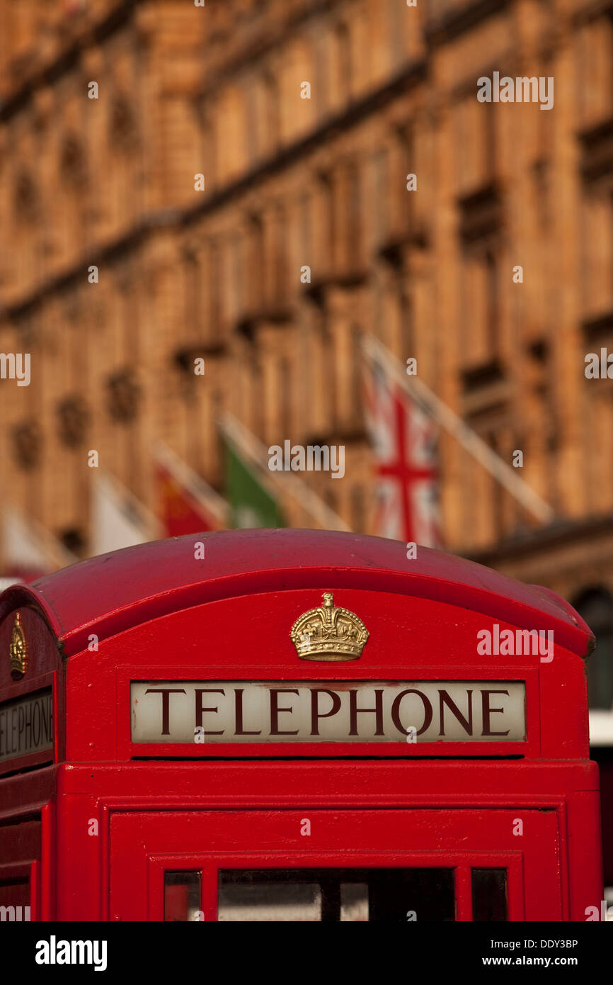 Traditional Red Telephone Box and Harrods Department Store, London, England - Stock Image