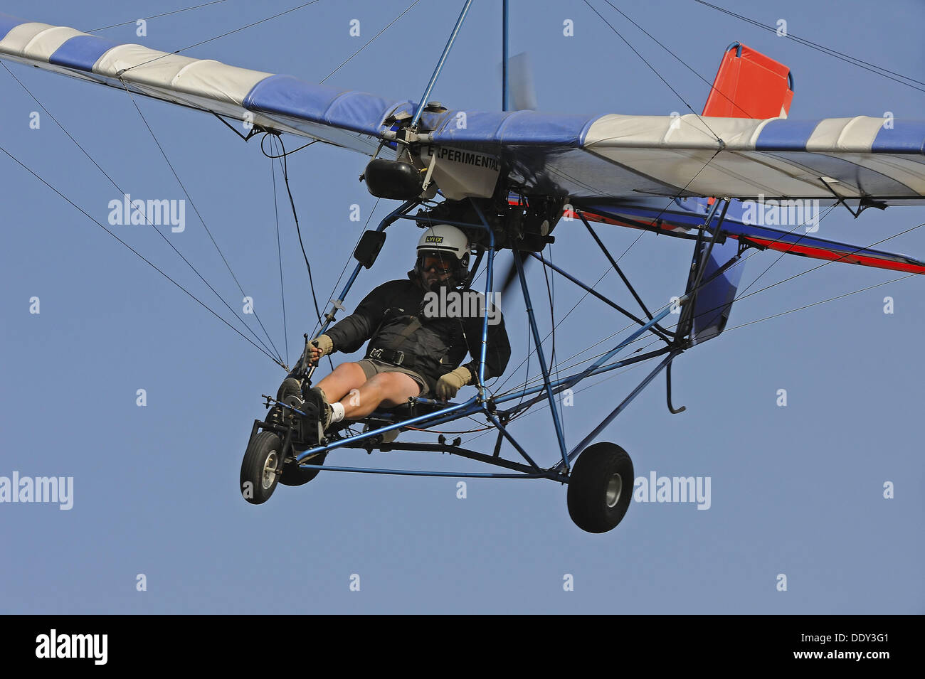 Single seat ultralight aircraft coming in for landing ...