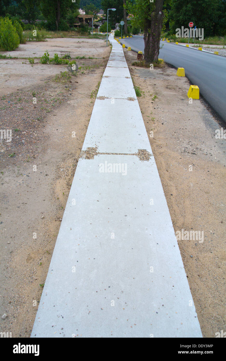 Footpath made out of concrete on an area under redevelopment Karlin district Prague Czech Republic Europe - Stock Image