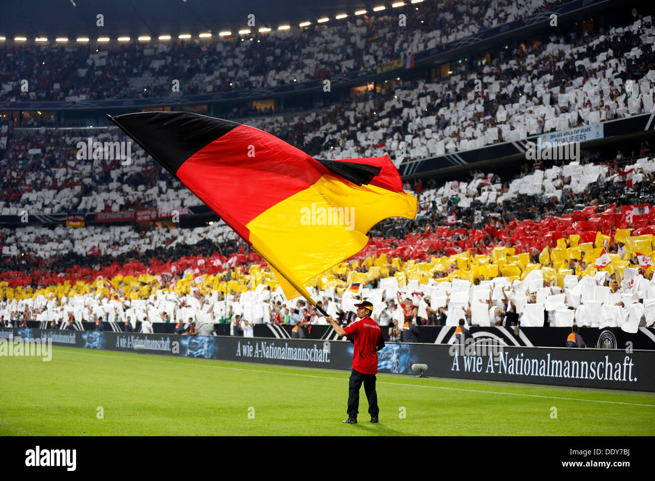 German Flag in front of the stadium, overview during the soccer match for the qualification of the world cup between Germany and Autria, Allianz Arena in Munich on September 06. 2013. - Stock Image
