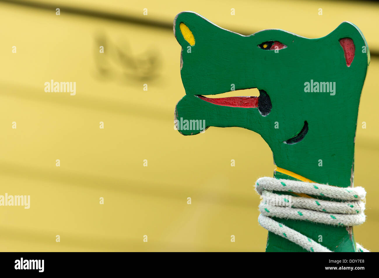 Dragon figure on the bow of a rowing boat - Stock Image