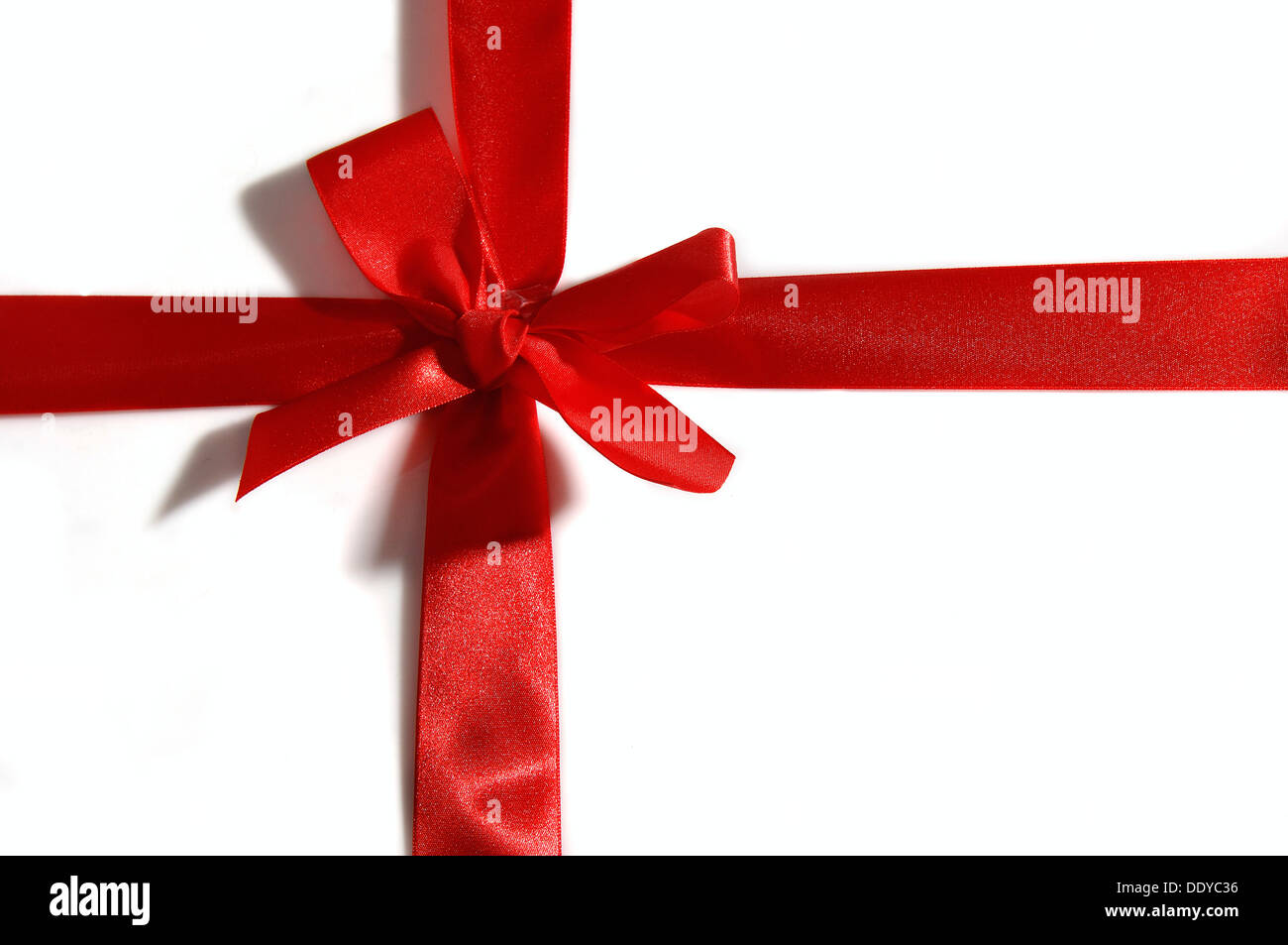 Red bow on a package Stock Photo