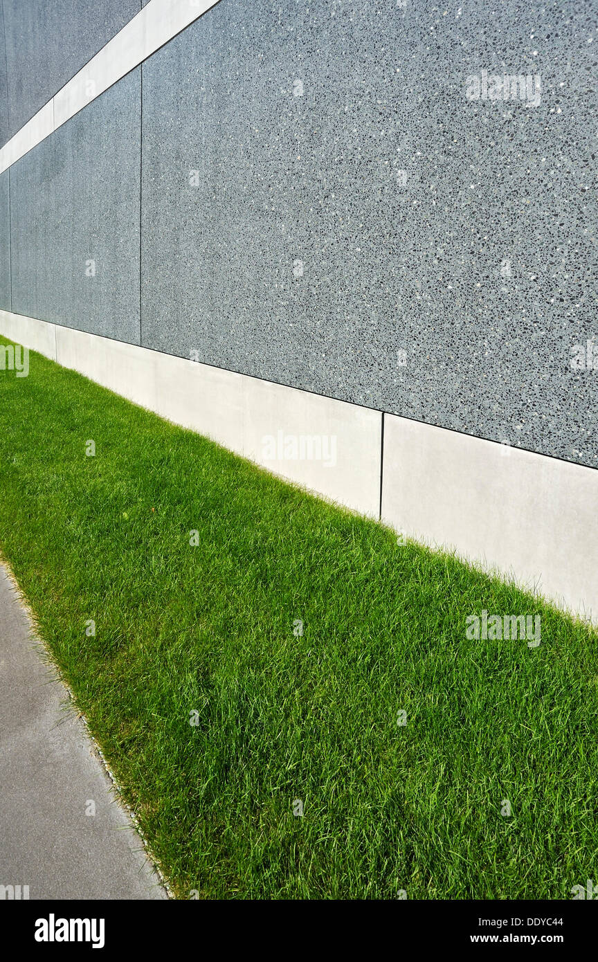 Wall of a building with a grass border, new Munich Re building, Mandlstrasse street, Munich, Bavaria - Stock Image