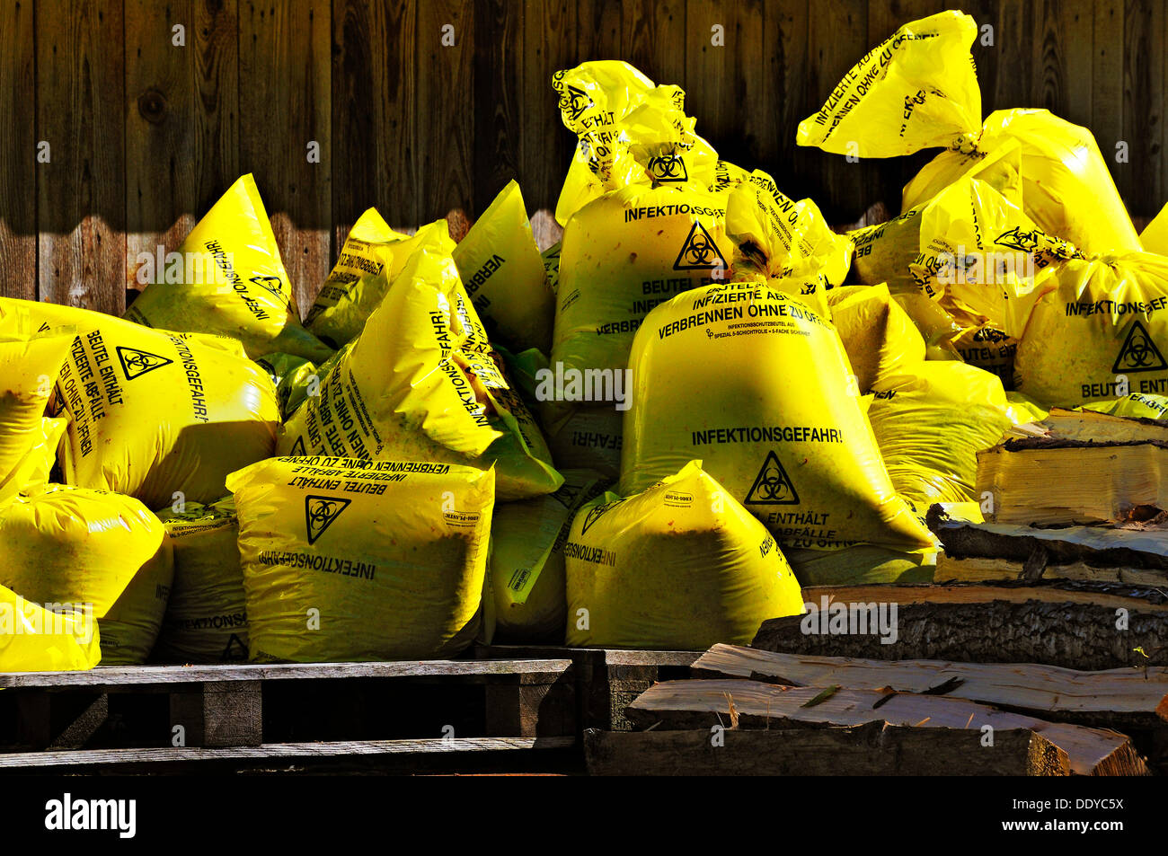 Yellow bags with infectious waste, Bavaria - Stock Image