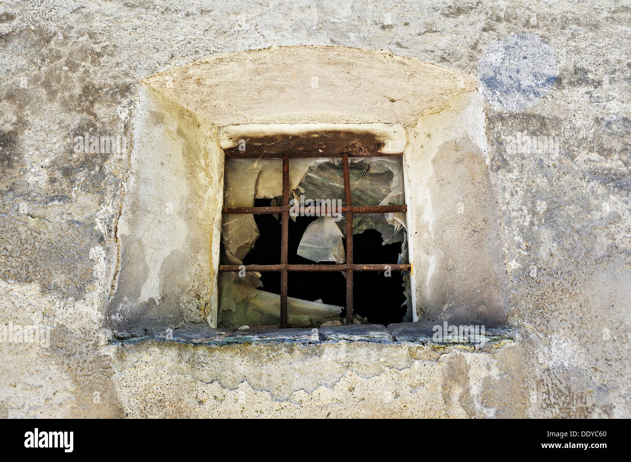 Old broken window with iron bars, Schaeftlarn Abbey, Schaeftlarn, Bavaria - Stock Image