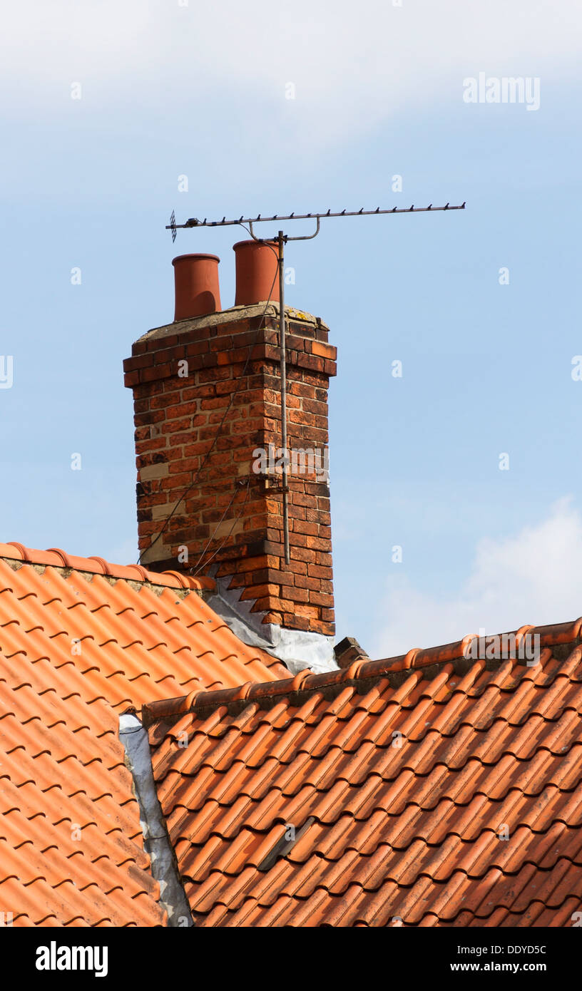 television aerial attached to an old chimney - Stock Image