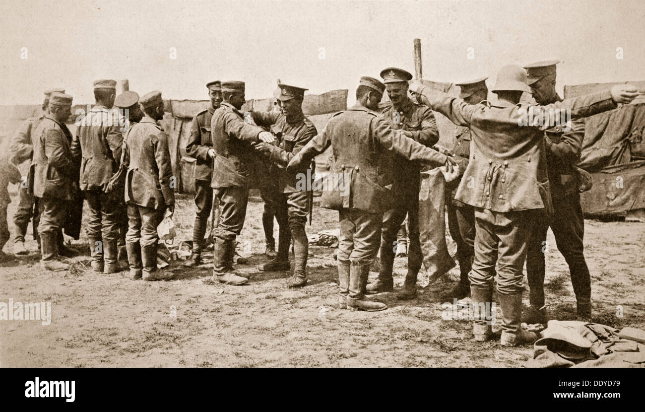 British soldiers searching captured German prisoners, Somme campaign, France, World War I, 1916. Artist: Unknown Stock Photo
