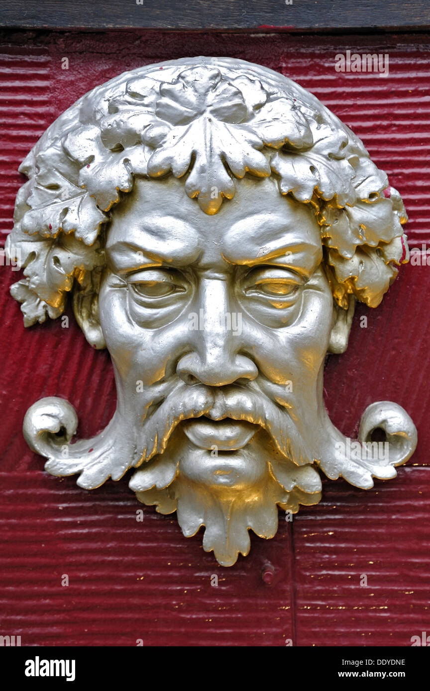 Bacchus, head of the Roman god on a wall - Stock Image