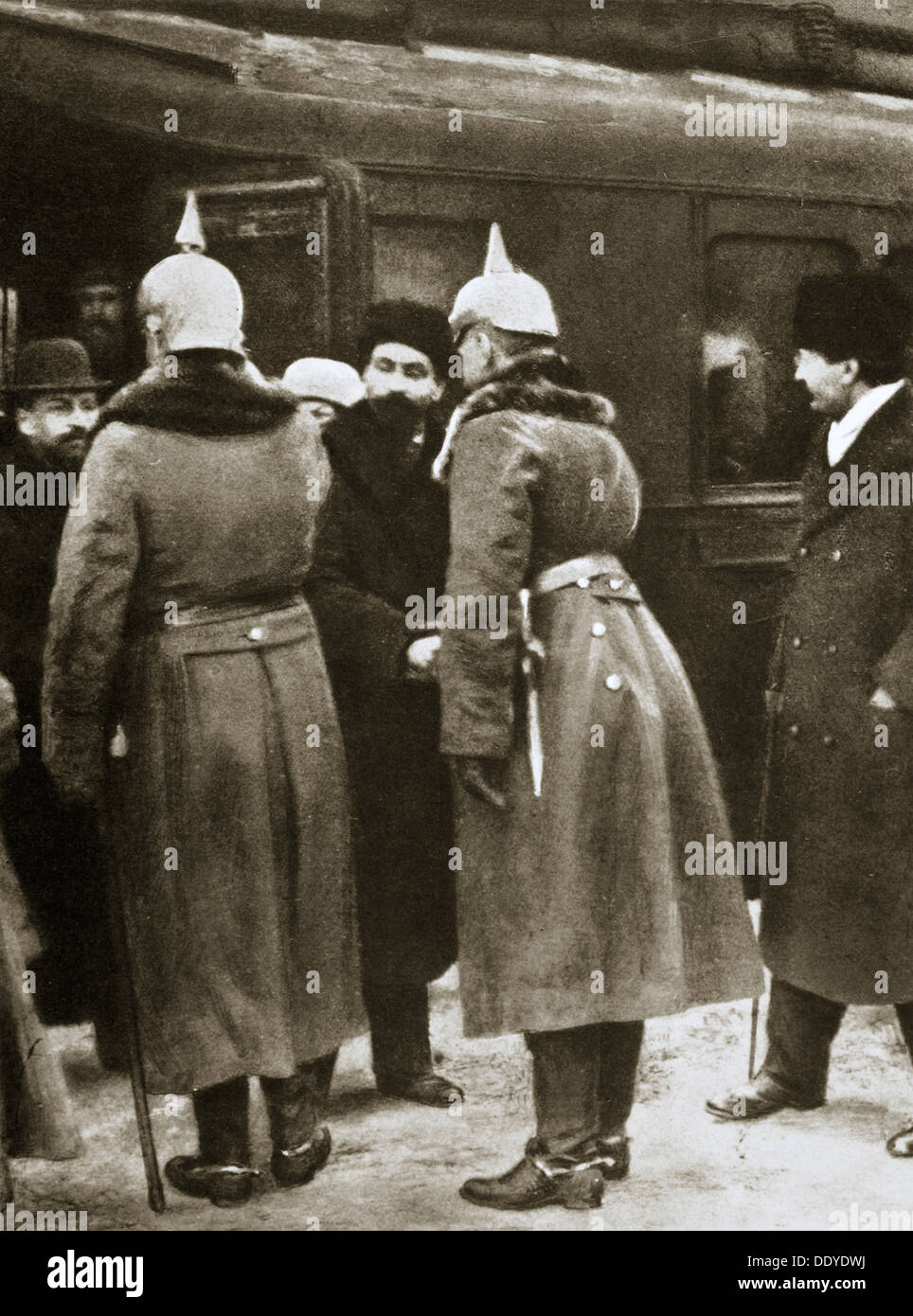 Trotsky and Russian delegates welcomed by German officers, Brest-Litovsk, Russia, 1917. Artist: Unknown - Stock Image