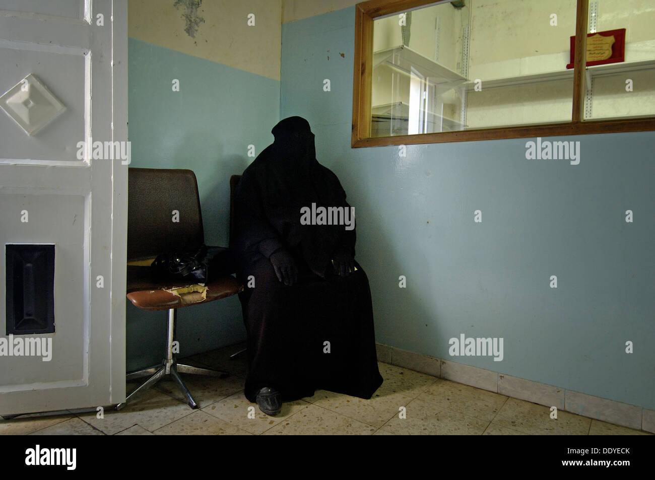 Palestinian woman wearing full black burqa garment in the west bank Israel - Stock Image