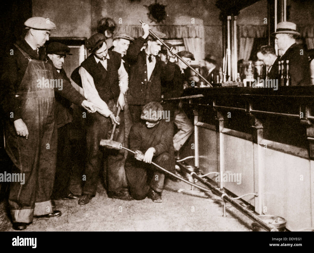 A bar in Camden, New Jersey, being forcibly dismantled by dry agents, USA, 1920s. Artist: Unknown - Stock Image