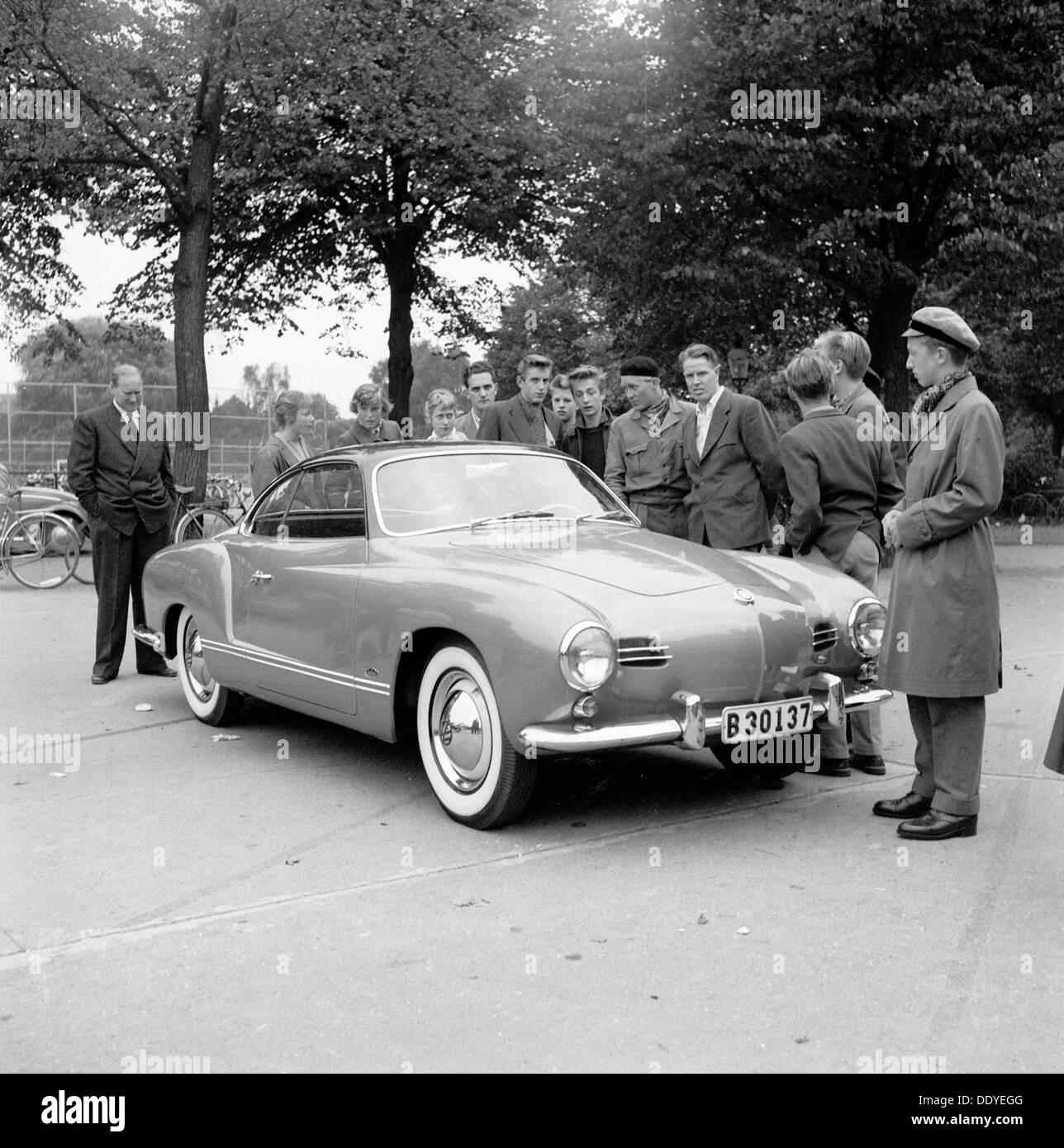 Young men admire the new Volkswagen Karmann Ghia, Landskrona, Sweden, 1955. Artist: Unknown Stock Photo