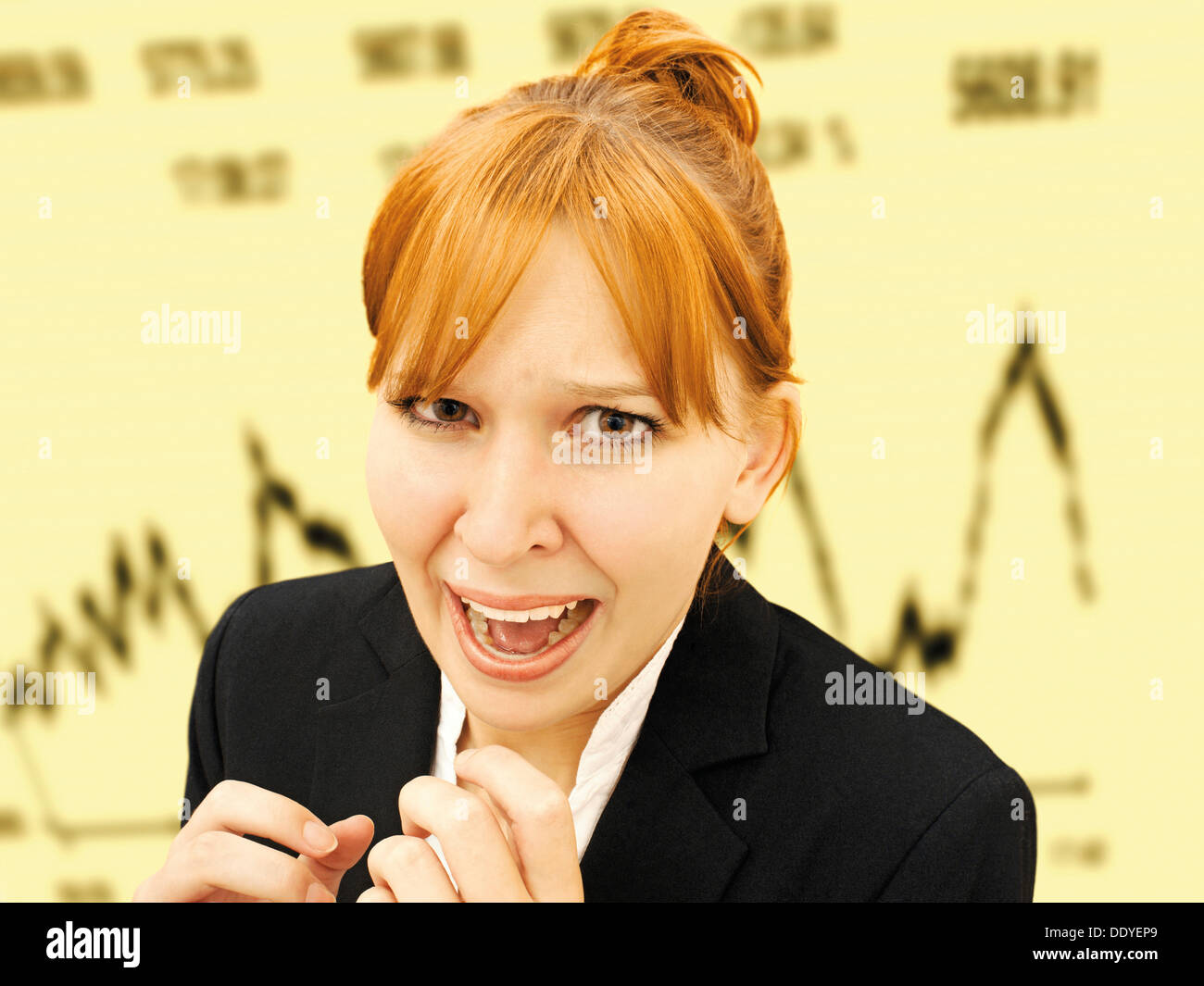 Portrait of an excited, hysterical businesswoman standing in front of a stock market index - Stock Image