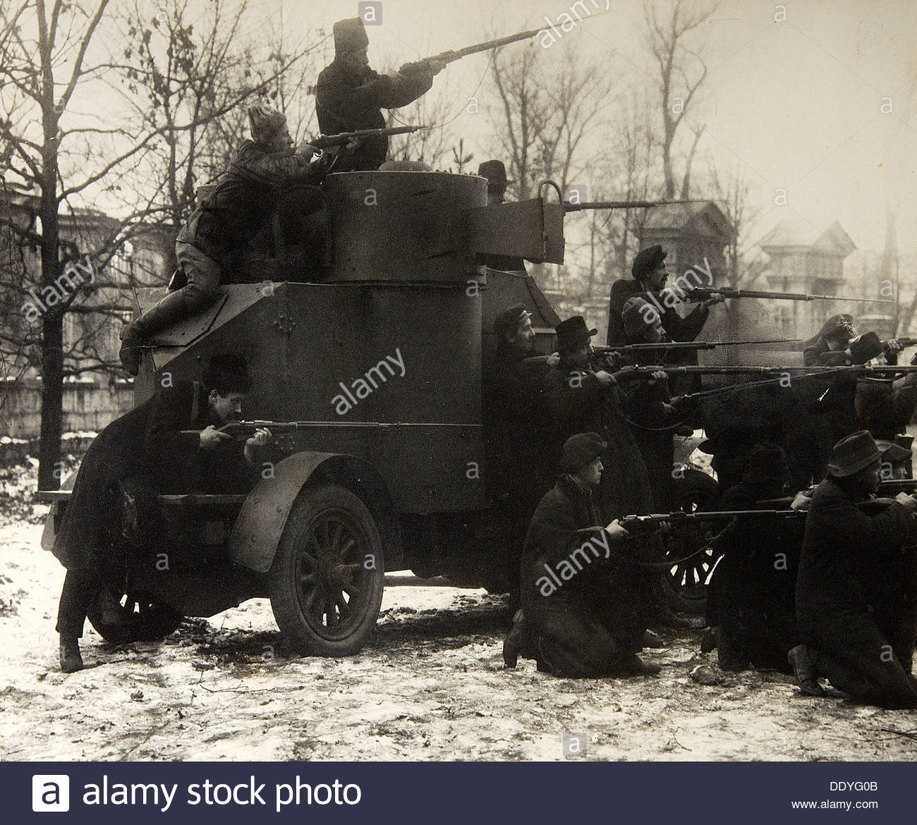 Red Guard soldiers with a captured armoured car, Petrograd, Russia, 25 October, 1917. Artist: Pyotr Otsup - Stock Image