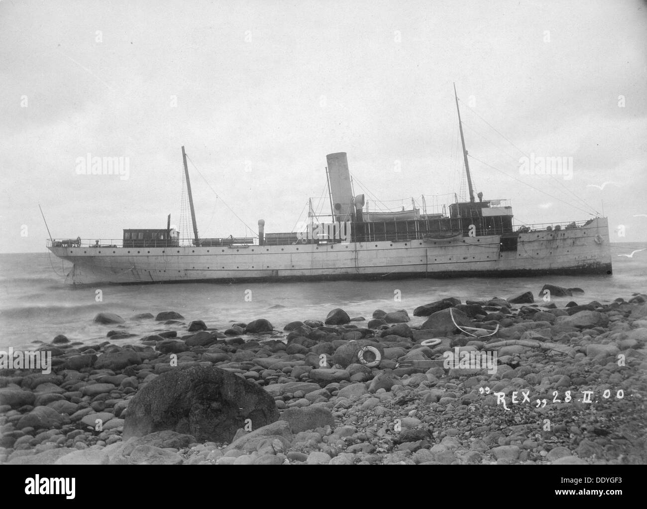 The mail Steamer 'Rex', wrecked near Lohme, on the north coast of Rügen, Germany, 28th February 1900. The Swedish vessel ran aground in fog on 27th February. Five women were drowned trying to escape from the stricken vessel. The wreck later broke in two. - Stock Image