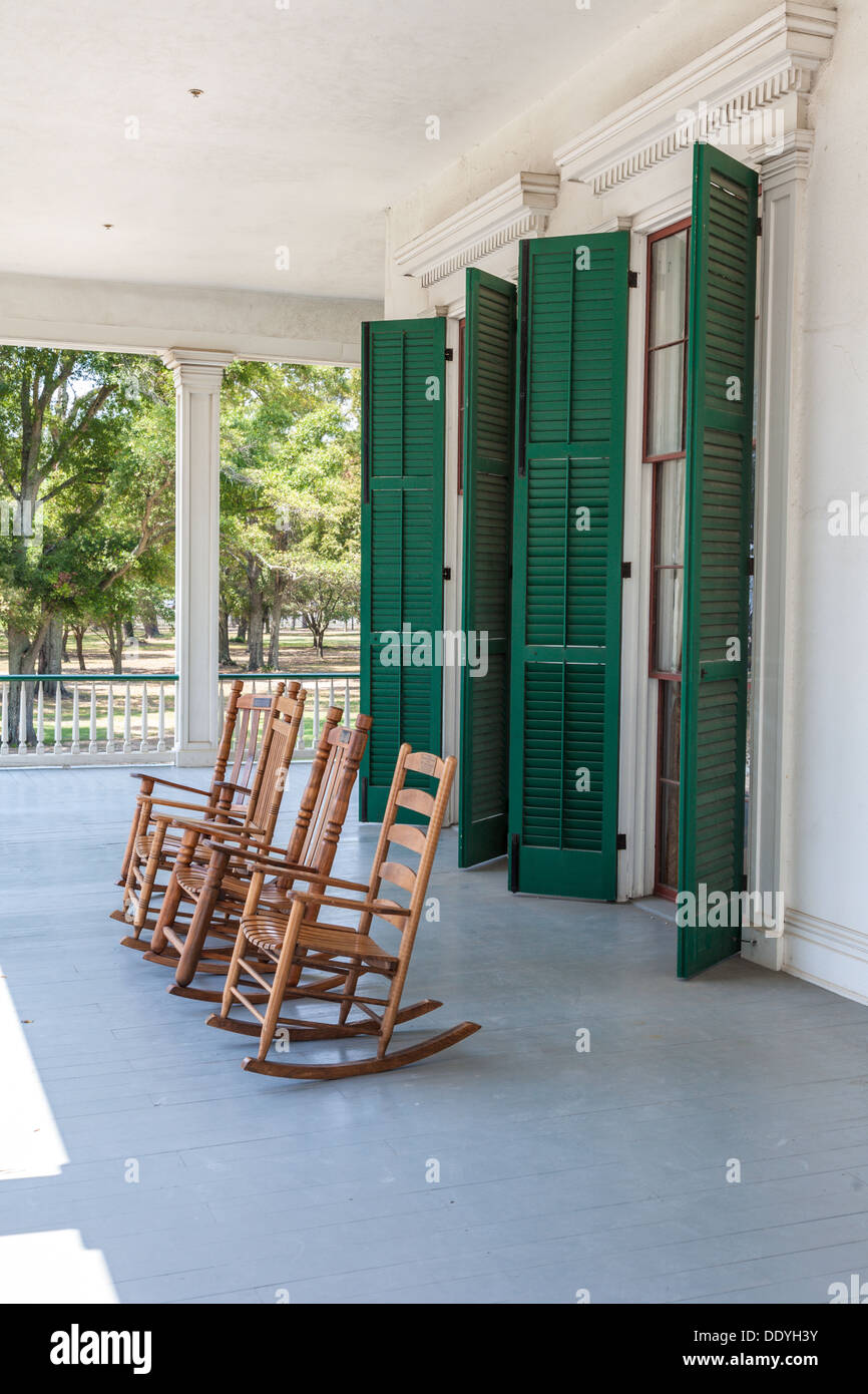 Rocking chairs on front porch of Library at Beauvoir Plantation, post-war home of President Jefferson Davis in Biloxi, MS - Stock Image