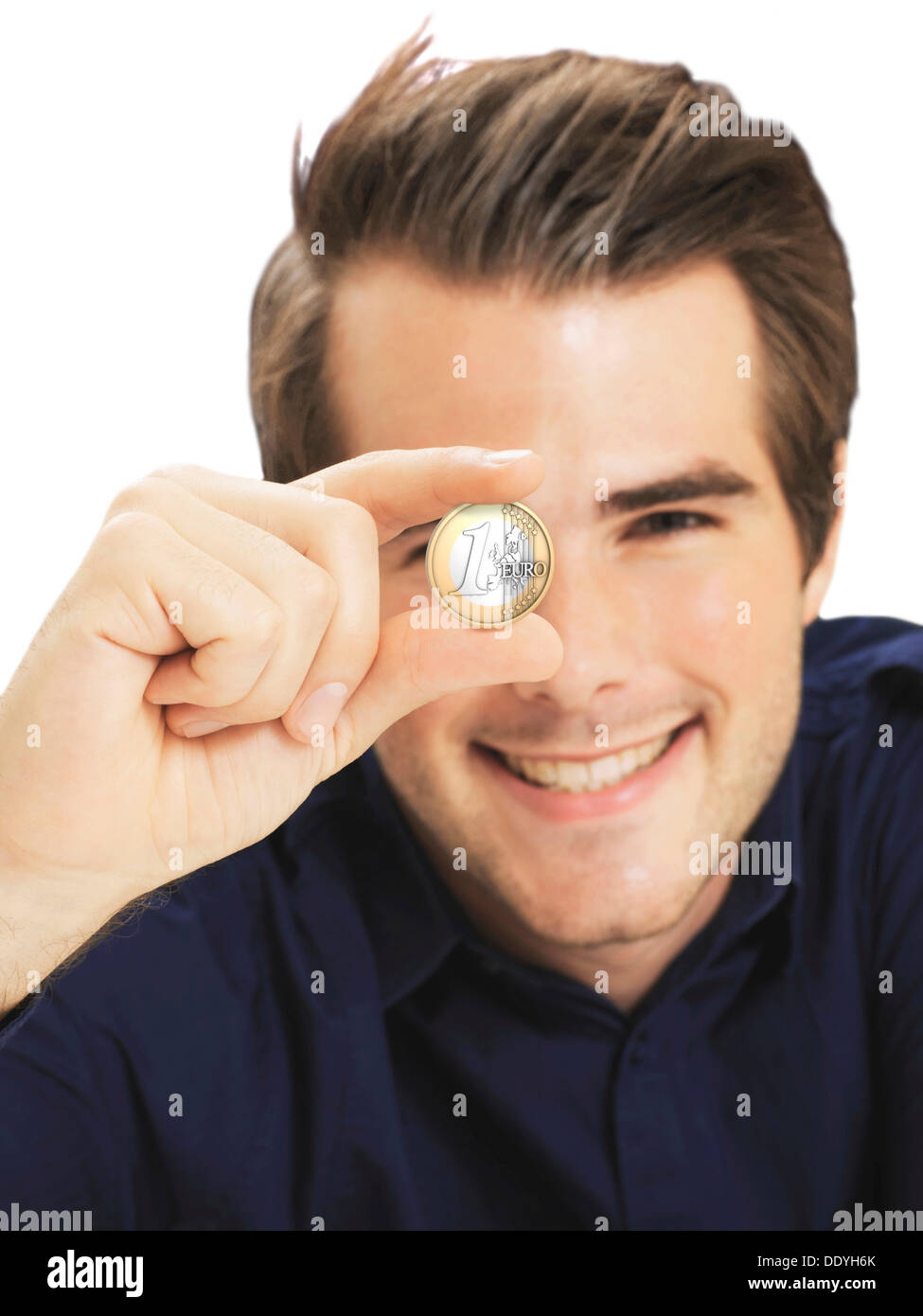 Businessman holding euro coin - Stock Image
