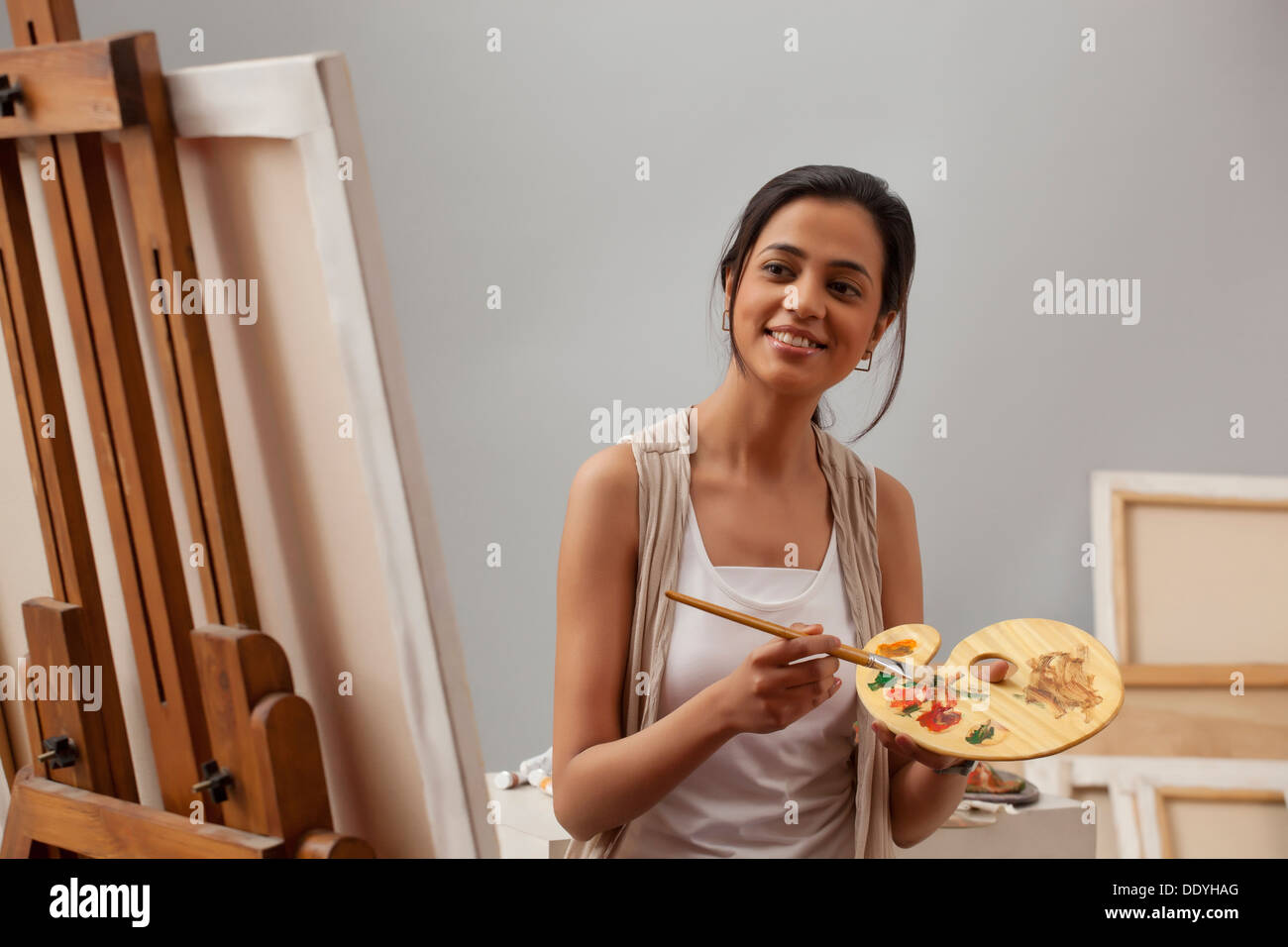Young Female Artist Painting On Canvas Stock Photo 60227960