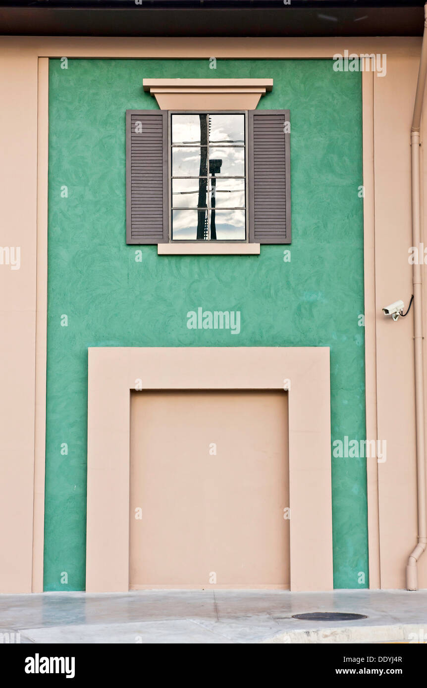Green wall stalemate and window. - Stock Image
