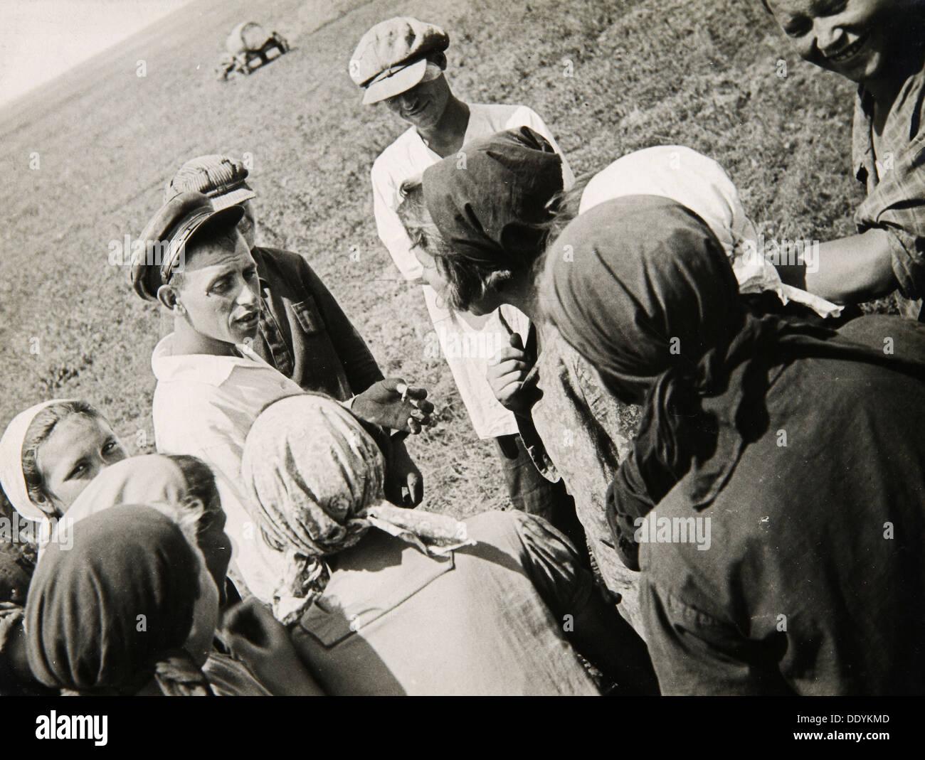 A Kolkhoz brigade taking a break, USSR, 1931. Artist: Anon - Stock Image