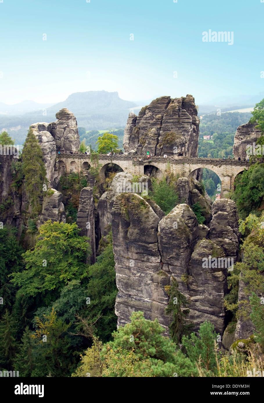 Basteibruecke bridge, Bastei rock formation, behind Mt. Lilienstein, Elbsandsteingebirge Elbe Sandstone Mountains - Stock Image
