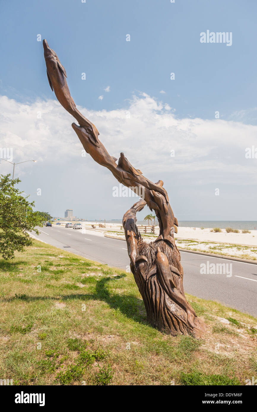 Dolphins tree carving by marlin miller a man who out of