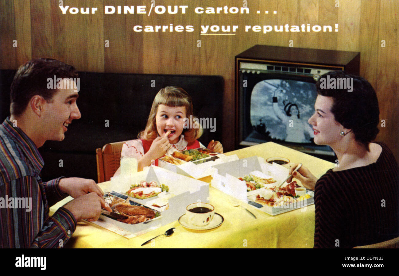 A family eating takeaway food in front of a television, Menasha, Wisconsin, USA, 1959. - Stock Image