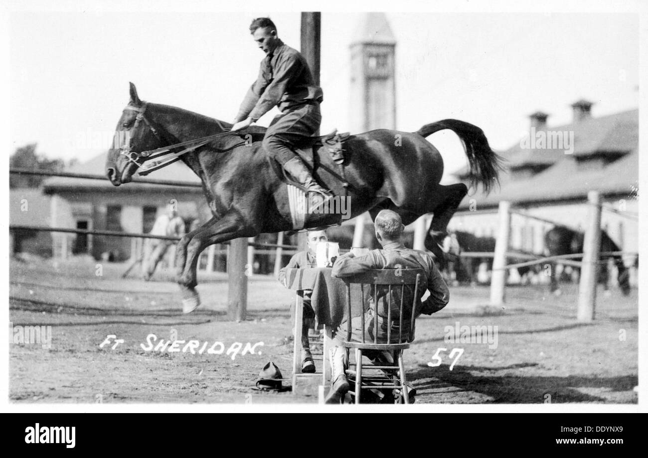 Soldiers performing equestrian stunts, Fort Sheridan, Illinois, USA, 1920. - Stock Image
