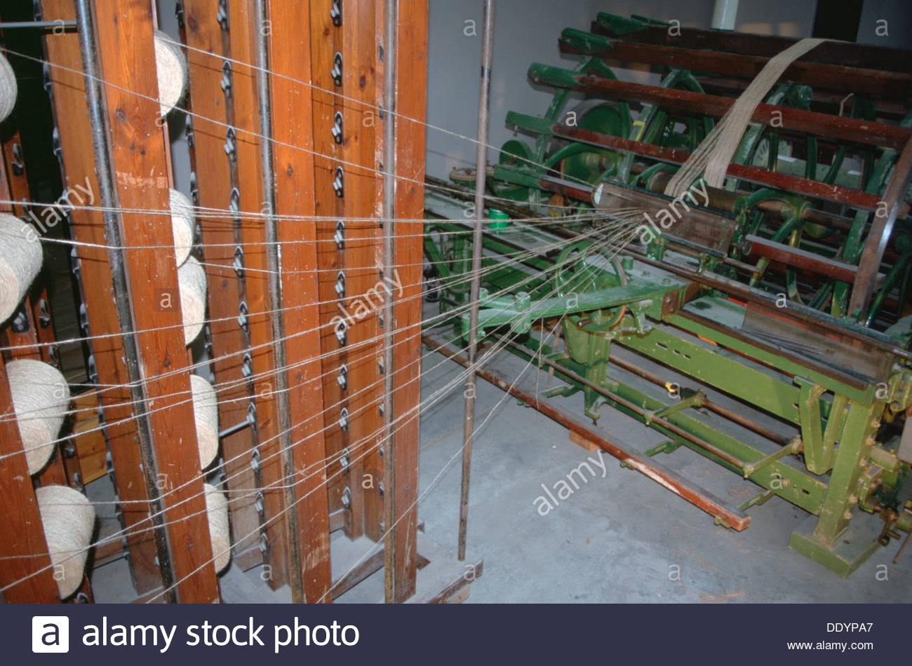 Creel for winding warp threads prior to beaming, Verdant Works Museum, Dundee, Scotland.  Artist: Dorothy Burrows - Stock Image