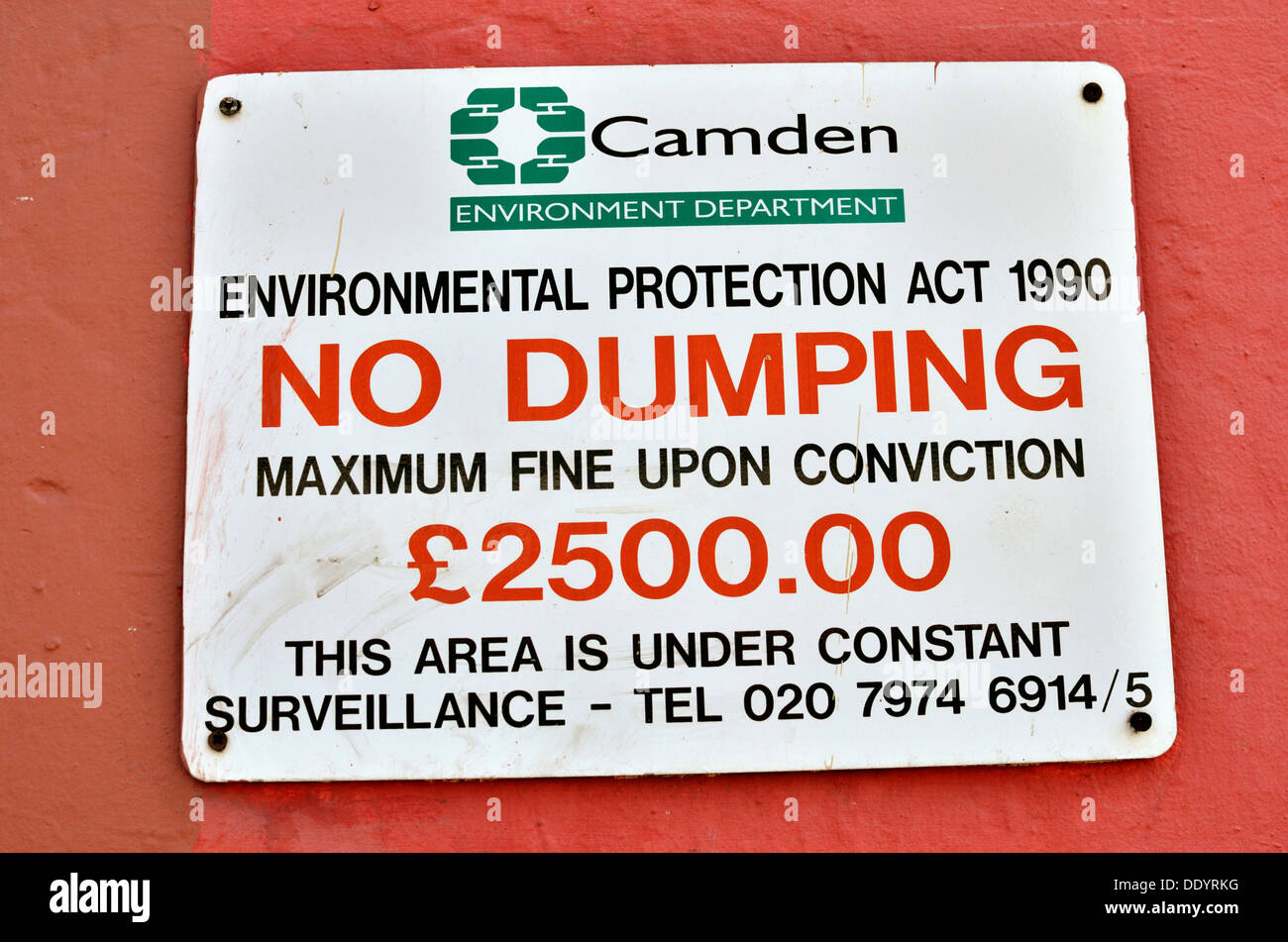 Camden Council 'No Dumping' sign on a wall, London, UK - Stock Image