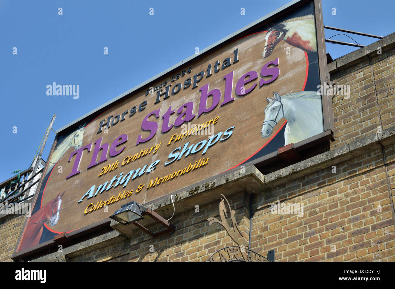 The Stables Horse Hospital antique shops sign, Camden Town, London, UK. - Stock Image