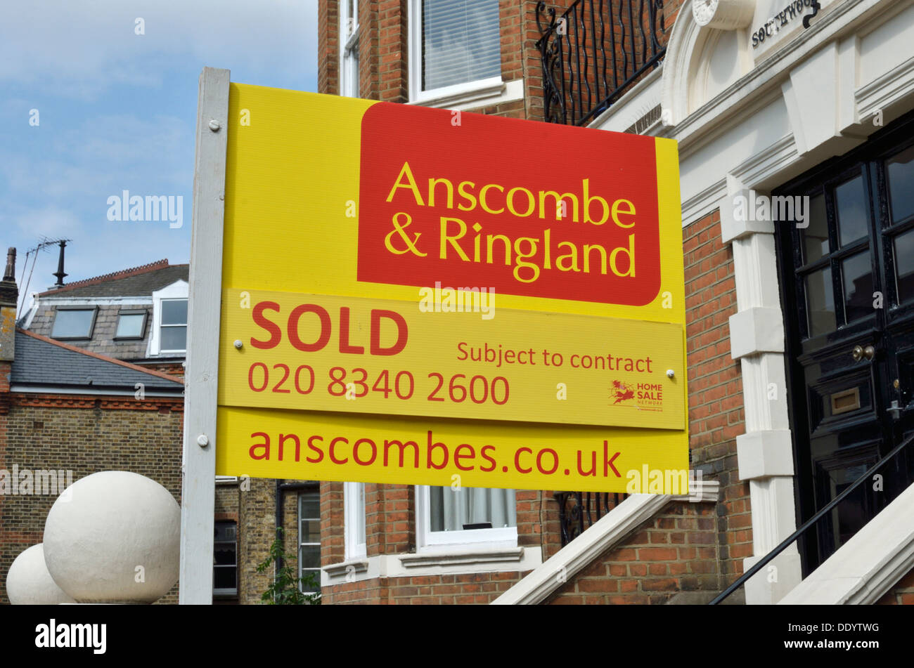 Ansscombe and Ringland 'Sold' estate agent sign outside a house in Highgate, London, UK. - Stock Image