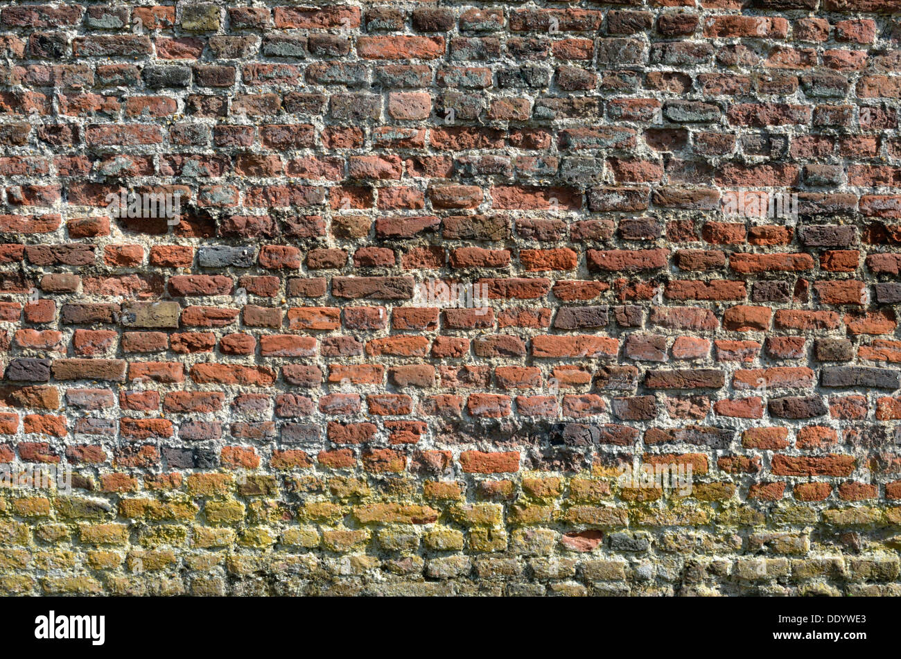 A very old red brick wall - Stock Image