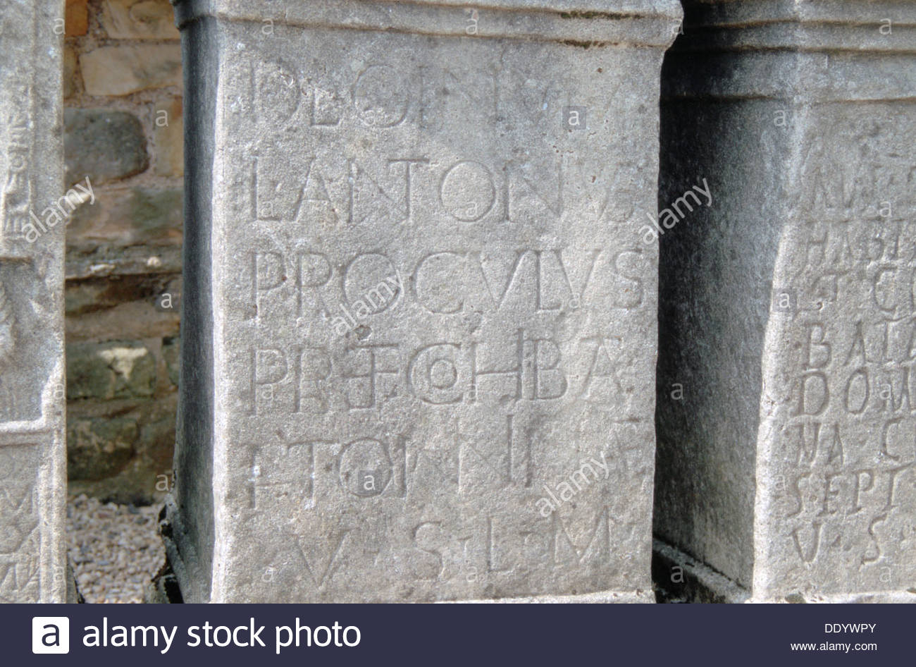Latin inscription on altar (replica), Temple of Mithras on Hadrian's Wall, Carrawburgh, Northumberla Artist: Dorothy Burrows - Stock Image