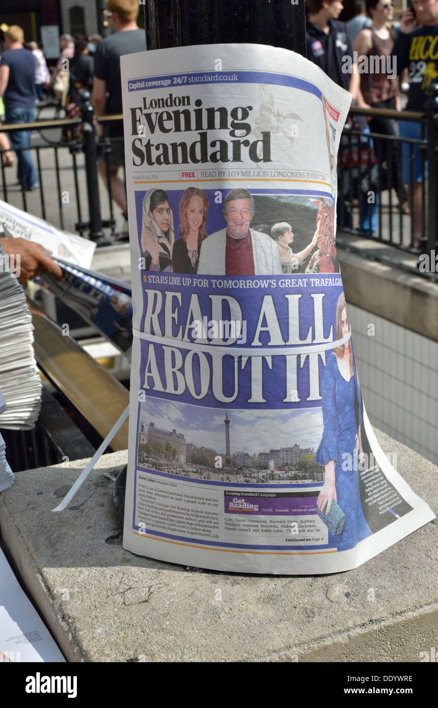 'Read All About It' headline in the Evening Standard newspaper, Oxford Circus, London, UK. - Stock Image