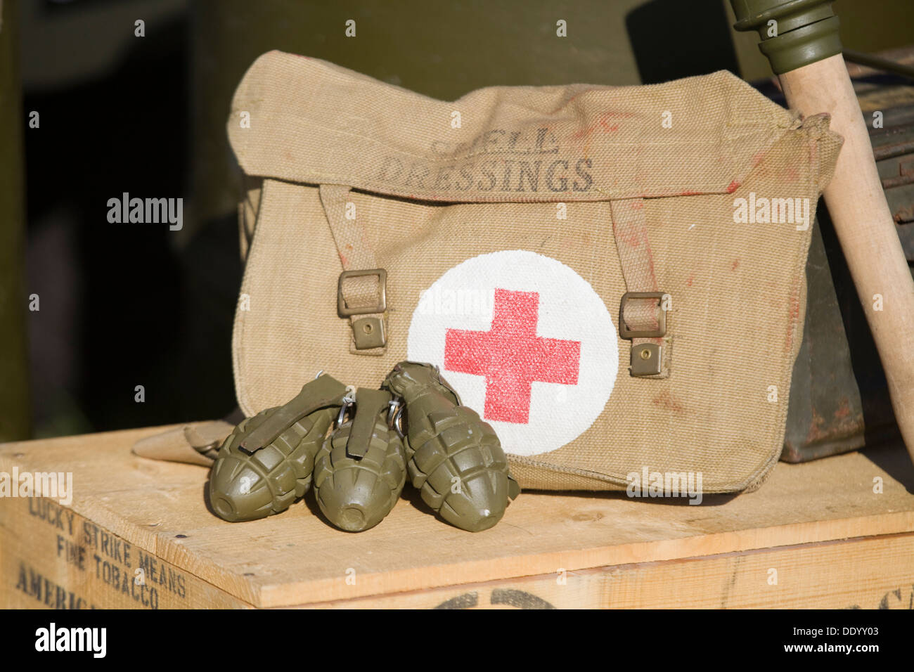 Vintage WW11 US Military Red Cross Field Dressing Bag with Hand Grenades on a wooden crate - Stock Image