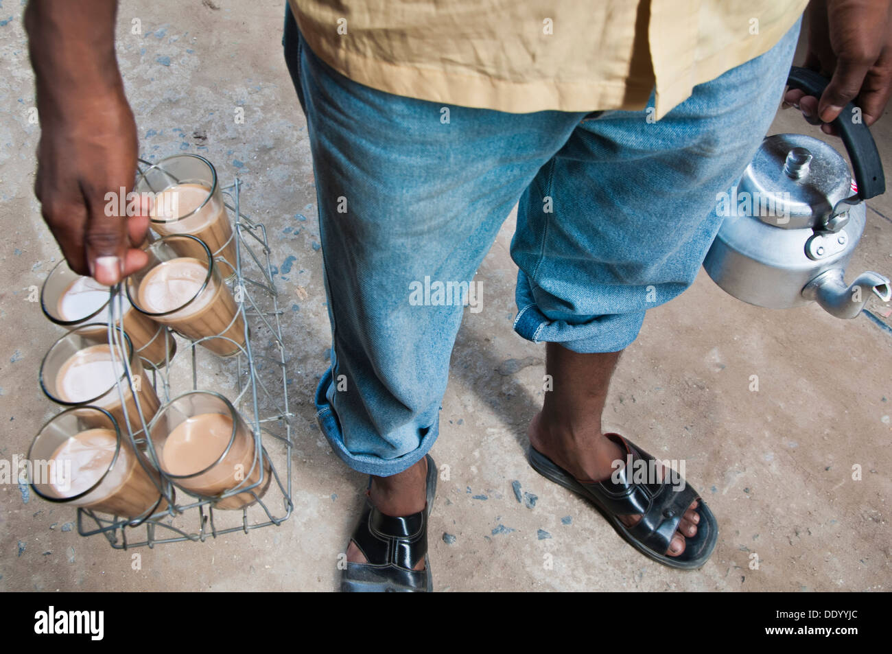 Low section of Indian street seller selling tea Stock Photo