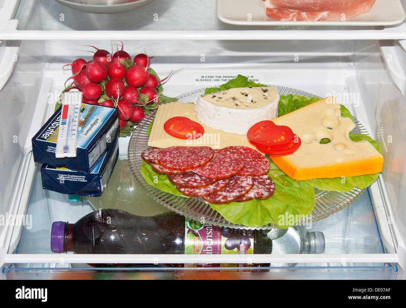 Wrong food storage in a fridge uncovered cheese platter sausage platter  sc 1 st  Alamy & Wrong food storage in a fridge uncovered cheese platter sausage ...
