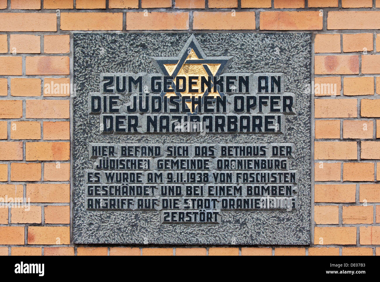 Memorial, plaque in memory of the Jewish victims of Nazi barbarism, in this place there was the synagogue of the Jewish - Stock Image
