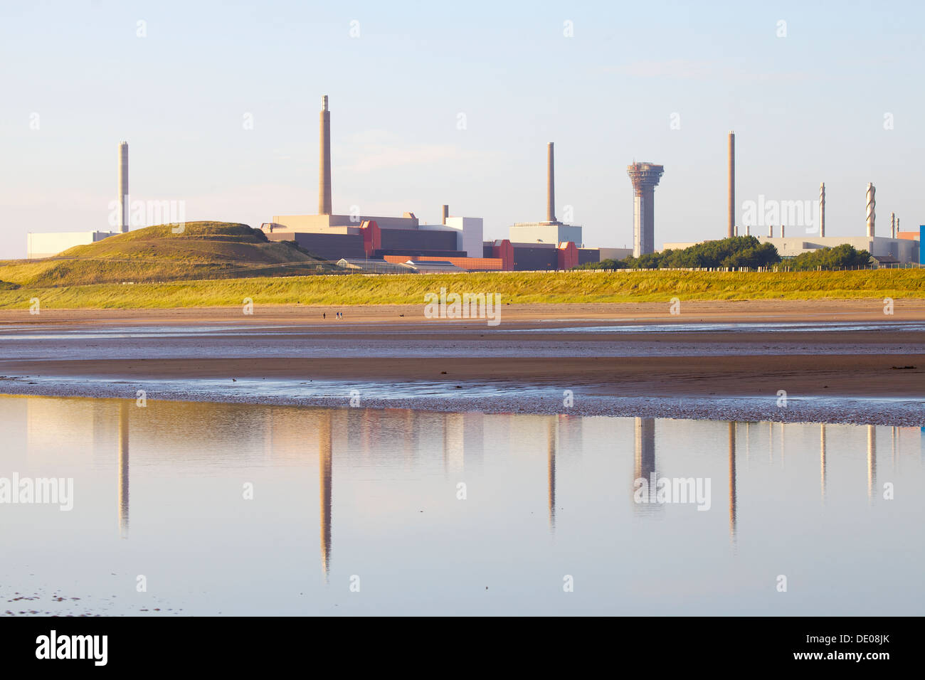 Sellafield nuclear power station reflected in a pool on the sea shore in front Cumbria England United Kingdom Great Britain - Stock Image