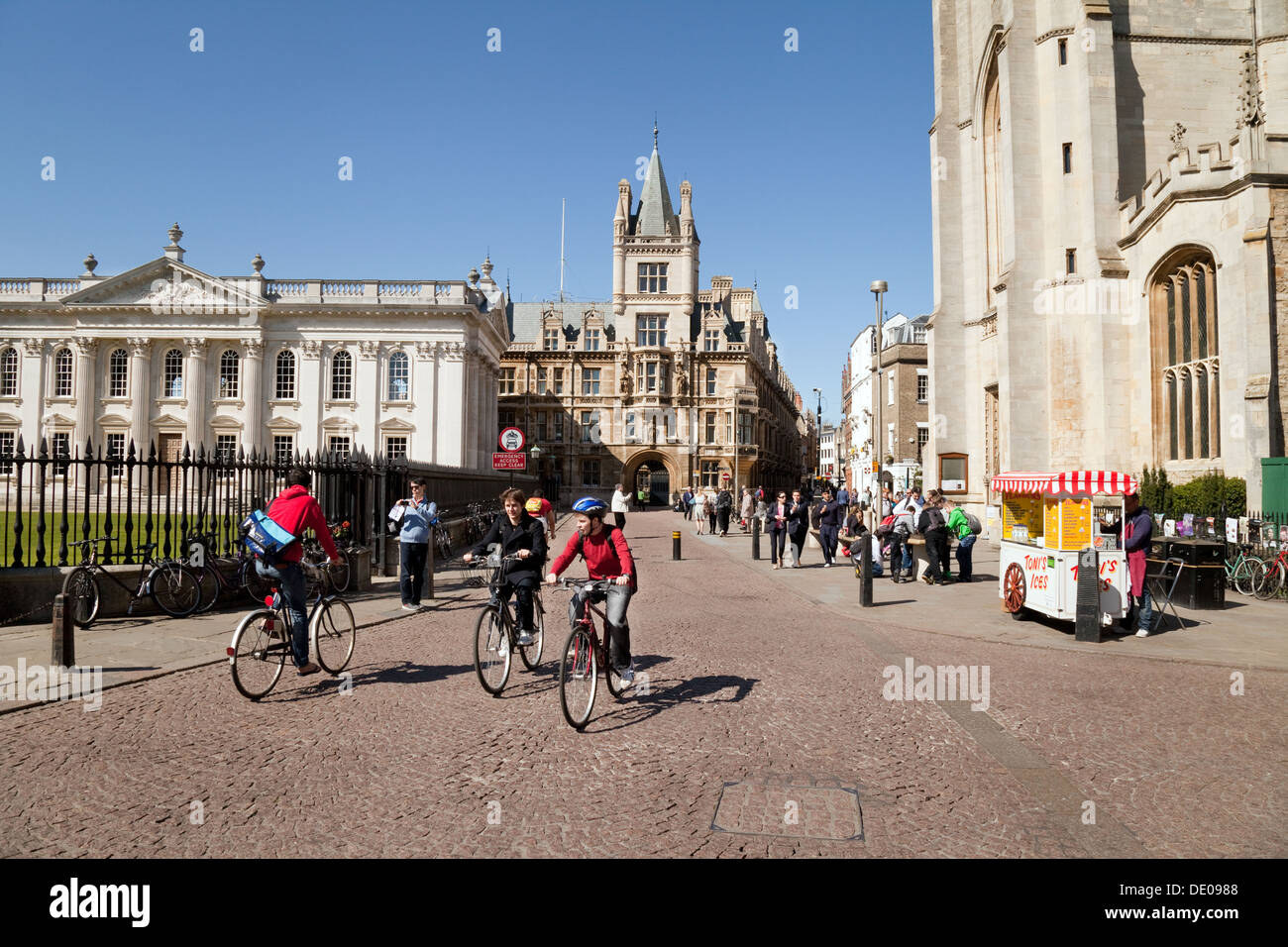Cyclists in Cambridge city centre cycling on Kings Parade on a sunny summers day, Cambridge UK - Stock Image