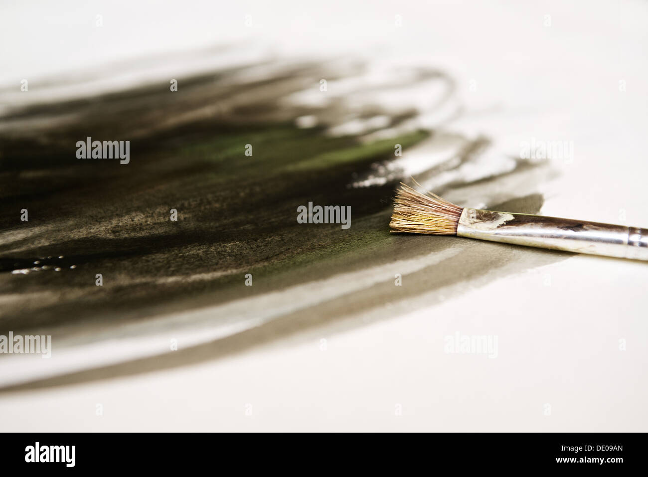 Paintbrush and paper, art school background - Stock Image