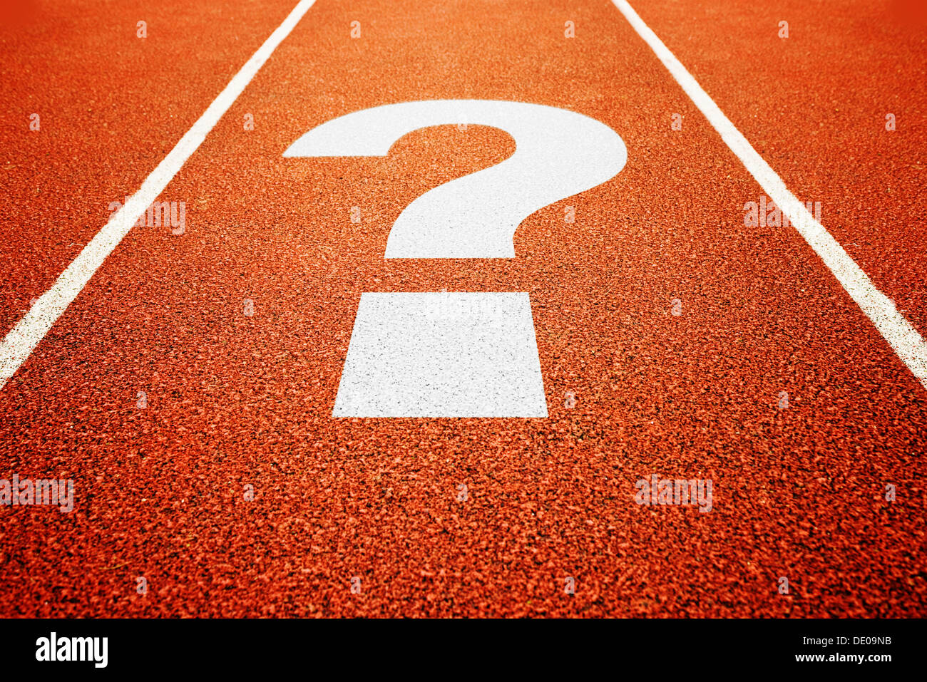 question mark on athletics all weather running track - Stock Image