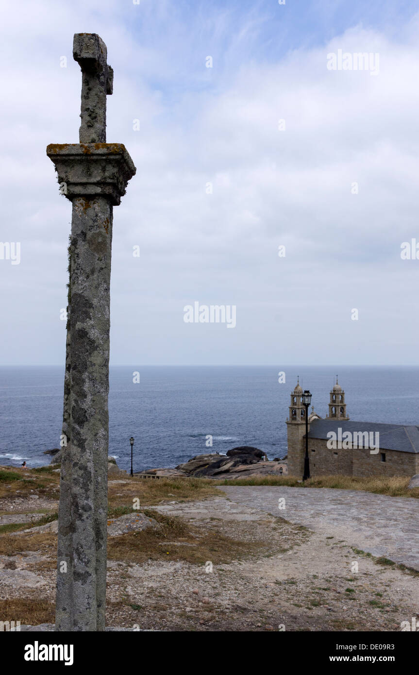 A stone cross, a cross typical way of St. James, is located near the church of St. Mary in the town of Muxia. - Stock Image