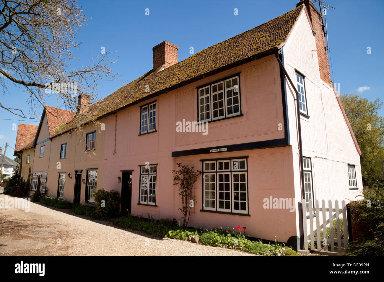 Traditional pink painted terraced houses in the village of Stoke By Clare, Suffolk East Anglia, England UK - Stock Image