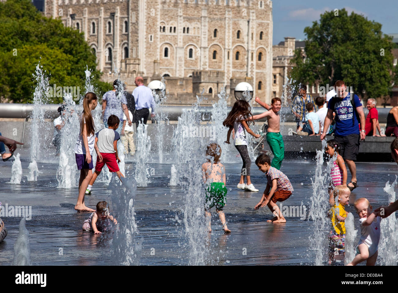 Children Playing In The Fountains Near The Tower Of London