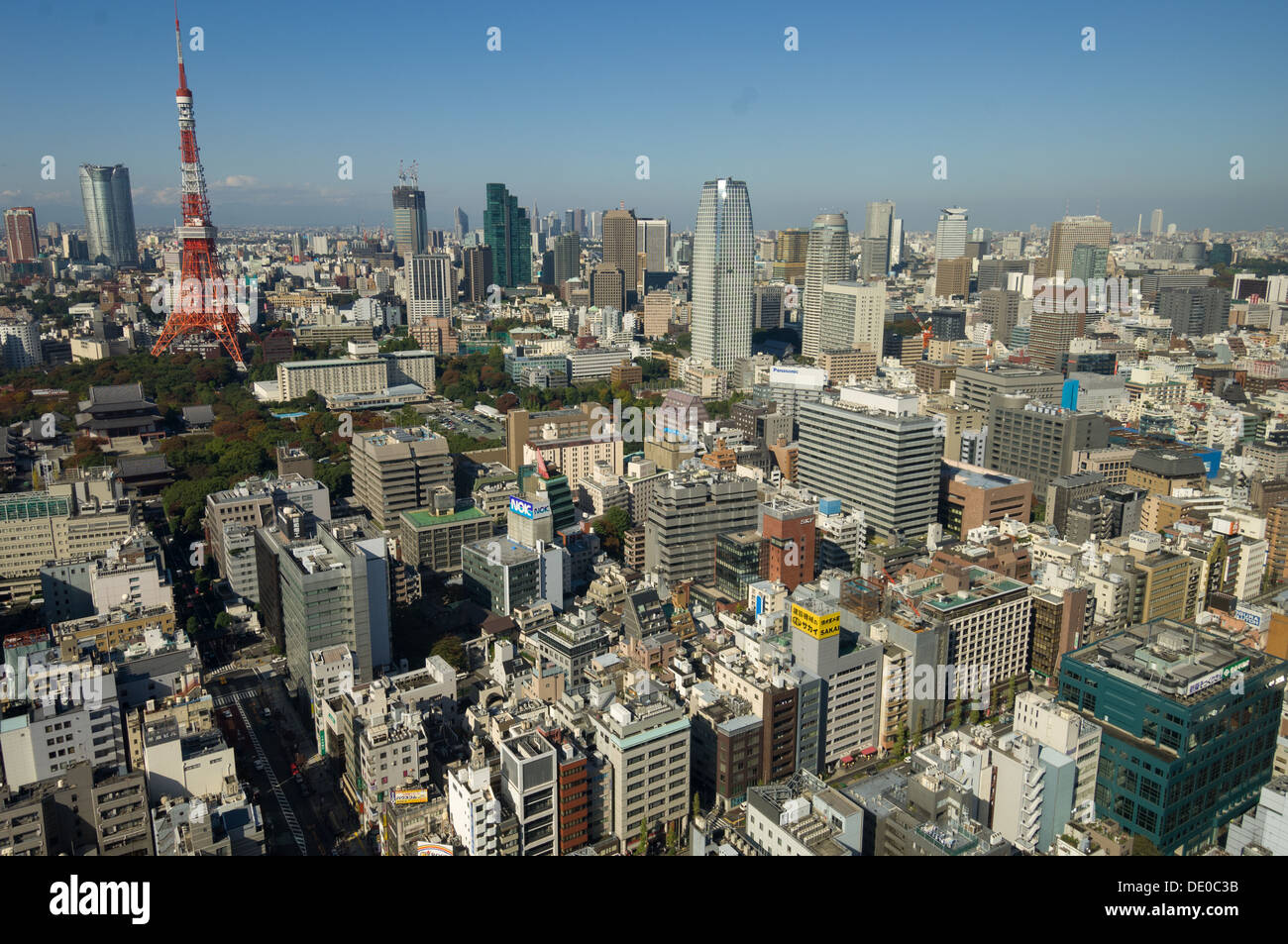 Cityscape of Tokyo showing the red Tokyo Tower, seen from the Observation Deck of the World Trade Center, Tokyo, Japan - Stock Image