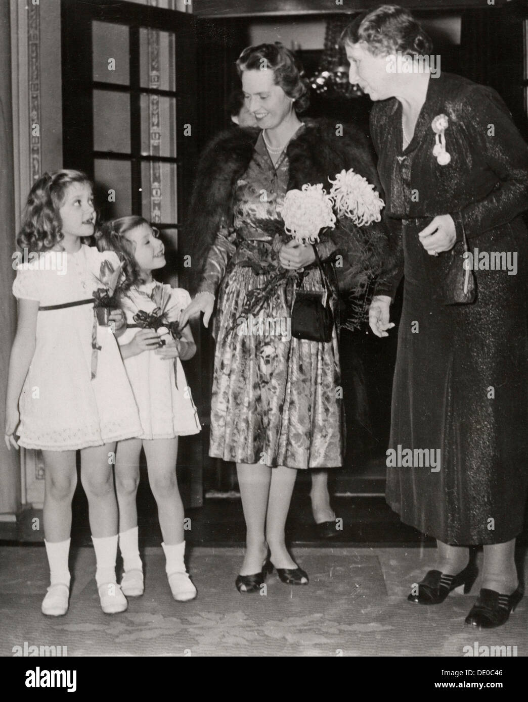 Swedish princesses visiting the Christmas concert at Stockholm Concert Hall, 1943. Princess Sibylla (1908-1972), wife of Prince Gustaf Adolf, Duke of Västerbotten, with two of their daughters, Princess Birgitta (1937-) and Princess Desiree (1938-). - Stock Image